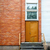 big brown door on a red brick and white planks wall stock photo © taigi