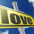 yellow road sign with love word under blue sky stock photo © tang90246