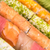 sushi · geserveerd · zwarte · plaat · houten · eetstokjes - stockfoto © tarczas