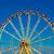 big wheel with multicolored cabins in amusement park stock photo © tarczas