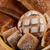 group of different breads type on wooden table stock photo © tarczas