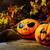 halloween symbol smiling pumpkin on dark rustic background stock photo © tasipas