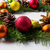 christmas wreath with red green orange and yellow ornaments stock photo © tasipas