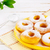 donuts with caster sugar served on yellow plate stock photo © tasipas