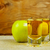 two cider glasses and green apples stock photo © tasipas