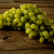bunch of green grapes on a dark wooden background stock photo © tasipas
