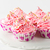 pink birthday cupcakes on cake stand stock photo © tasipas