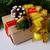 dourado · papel · de · embrulho · arco · apresentar · decoração · natal - foto stock © tasipas