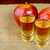 two schnapps drinks and red apples stock photo © tasipas