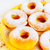 icing homemade donuts on yellow plate stock photo © tasipas