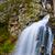 breathtaking waterfall in mountains stock photo © tasipas
