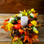 thanksgiving centerpiece with candle and artificial fall leaves stock photo © tasipas