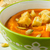 pumpkin soup in a green bowl close up stock photo © tasipas