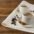 coffee mugs on linen napkin stock photo © tasipas