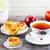 cup of tea and muffins with rose shaped apple slices stock photo © tasipas