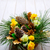 christmas table centerpiece with golden pine cones and fir branc stock photo © tasipas