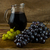 bunch of grapes and wine jug stock photo © tasipas