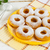 caster sugar powdered donuts on yellow plate stock photo © tasipas