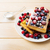 belgian waffles with blueberry raspberry and ising sugar stock photo © tasipas