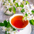 cup of tea on wooden table and apple blossom stock photo © tasipas