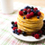 breakfast pancakes with honey and fresh berries and coffee mug stock photo © tasipas