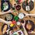 barátok · ebéd · együtt · otthon · étel · nők - stock fotó © tommyandone
