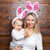 happy mother and her cute child wearing bunny ears getting ready for easter stock photo © tommyandone