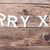 merry christmas sign on wooden background stock photo © tommyandone