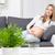 счастливым · красивой · беременная · женщина · расслабляющая · диван · семьи - Сток-фото © tommyandone