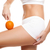 Woman with an orange showing a perfect skin  stock photo © tommyandone