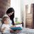 gelukkig · moeder · spelen · baby · vergadering · bed - stockfoto © tommyandone