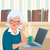 Elderly woman using a laptop stock photo © UrchenkoJulia