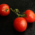 Branch of fresh tomatoes on black background stock photo © user_11056481