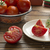 fresh ripe tomatoes in bowl half of cutted tomato stock photo © user_11056481