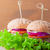 cheeseburger with tomato onion and green salad stock photo © user_11224430