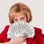 nő · pénz · fiatal · nő · köteg · dollár · bankjegyek - stock fotó © user_9834712