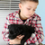 nino · cachorro · hermosa · rubio · negro · ventana - foto stock © vanessavr