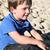 menino · enterrado · praia · criança · diversão - foto stock © vanessavr