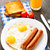 Fried eggs with sausages. stock photo © vankad