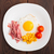 Fried egg with ham and vegetables stock photo © vankad