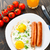 frito · huevos · salchichas · placa · naranja · beber - foto stock © vankad
