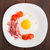 Fried egg with ham and tomato stock photo © vankad