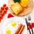 eieren · worstjes · plaat · oranje · drinken - stockfoto © vankad