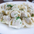 fresh boiled meat dumplings served with dill stock photo © vankad