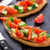 Bruschetta with tomato, avocado and herbs stock photo © vankad