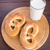 homemade warm soft pretzels and glass of milk stock photo © vankad