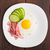 Fried egg with ham and cucumber stock photo © vankad