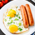 fried eggs with sausages stock photo © vankad