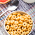 bowl of honey corn rings stock photo © vankad