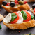 bruschetta with tomatoes mozzarella and basil stock photo © vankad